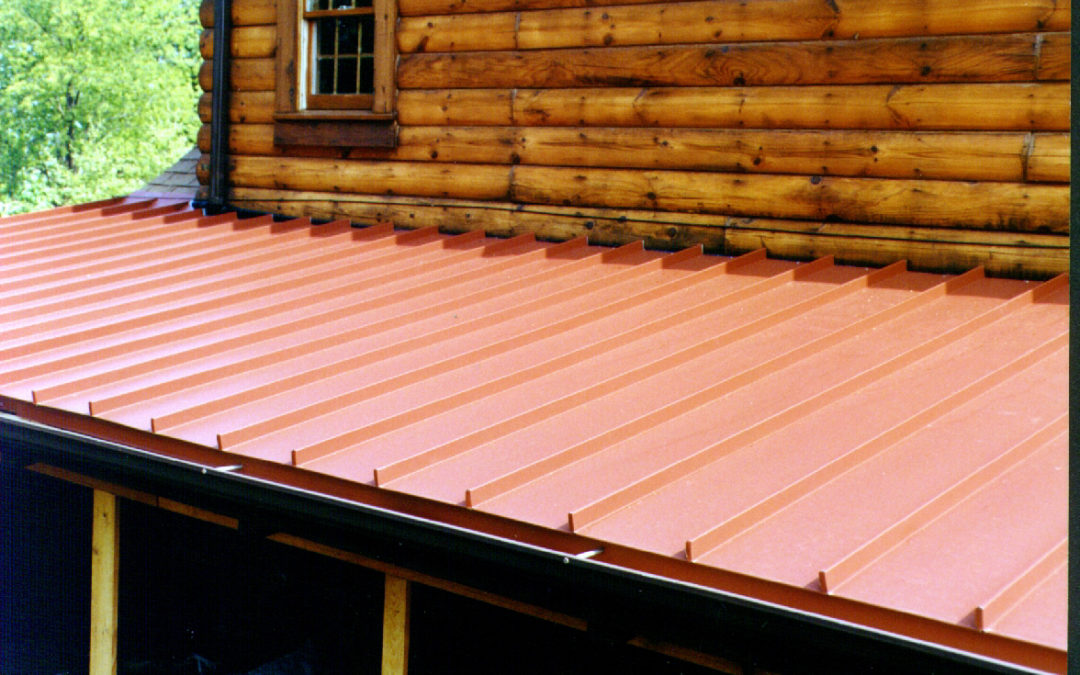 Red Standing Seam Metal Roof Awning on wood finished house