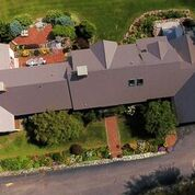 Arial View from drone of a Cedar Shake Metal Roof overlooking property