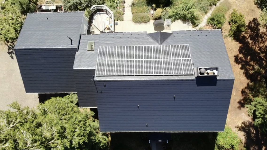Top down look at metal roof with solar panels
